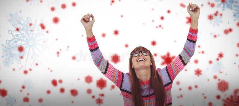 Sammansatt bild av att le hipsterkvinnan som använder bärbara datorn, medan sätta upp händer royaltyfri bild