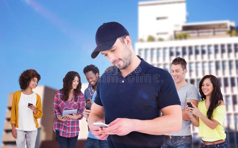 Sammansatt bild av att le mannen som använder mobiltelefonen royaltyfria foton