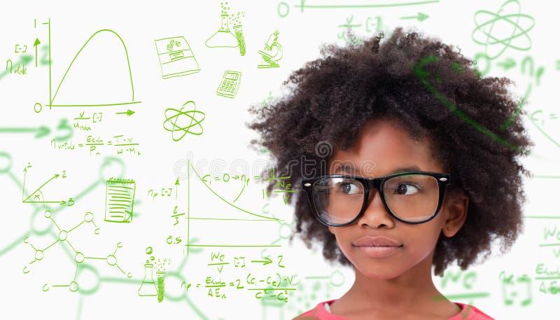 Sammansatt bild av bärande exponeringsglas för gullig elev arkivfoto