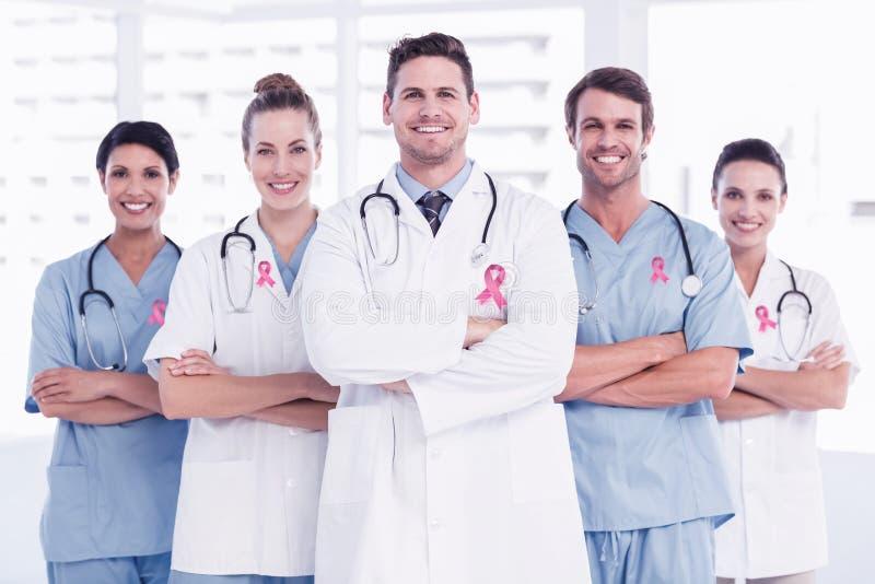 Sammansatt bild av bröstcancermedvetenhetbandet fotografering för bildbyråer