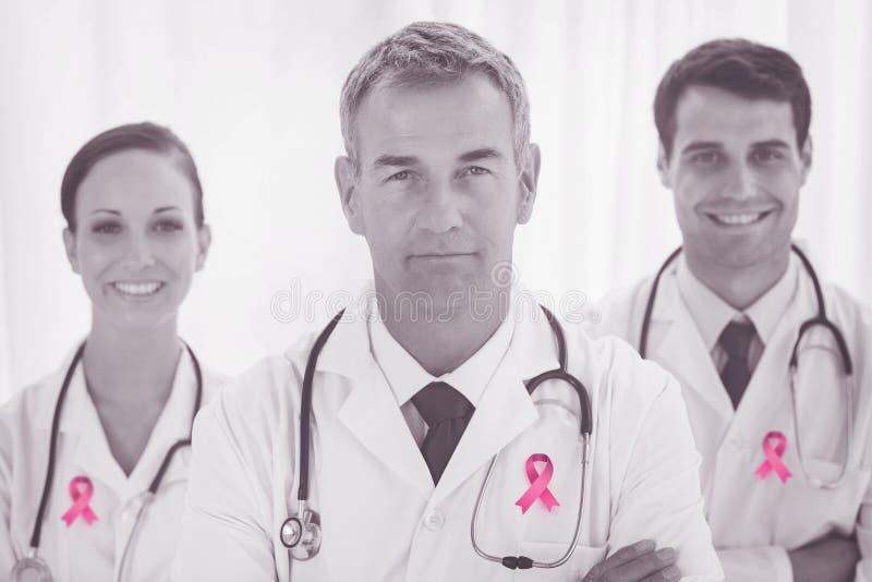 Sammansatt bild av bröstcancermedvetenhetbandet royaltyfri bild