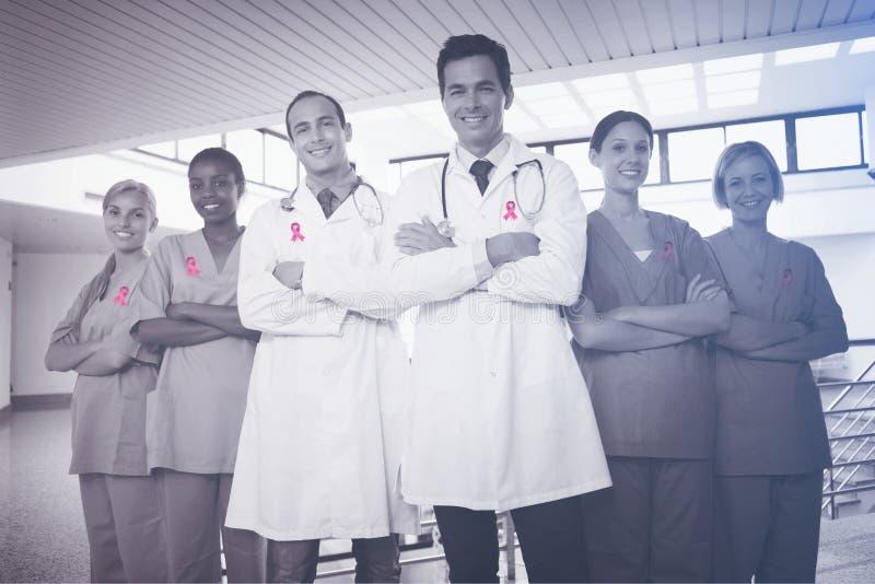 Sammansatt bild av bröstcancermedvetenhetbandet royaltyfria bilder
