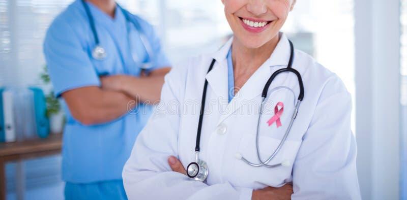 Sammansatt bild av bröstcancermedvetenhetbandet arkivfoto
