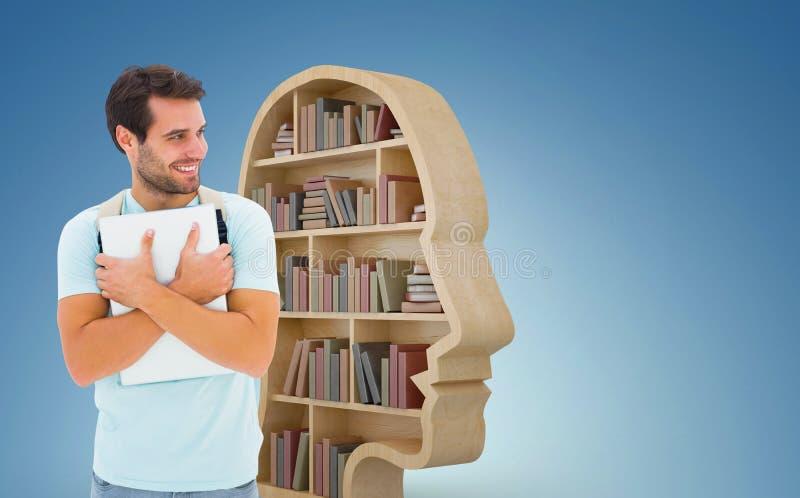Sammansatt bild av den hållande bärbara datorn för student arkivfoton