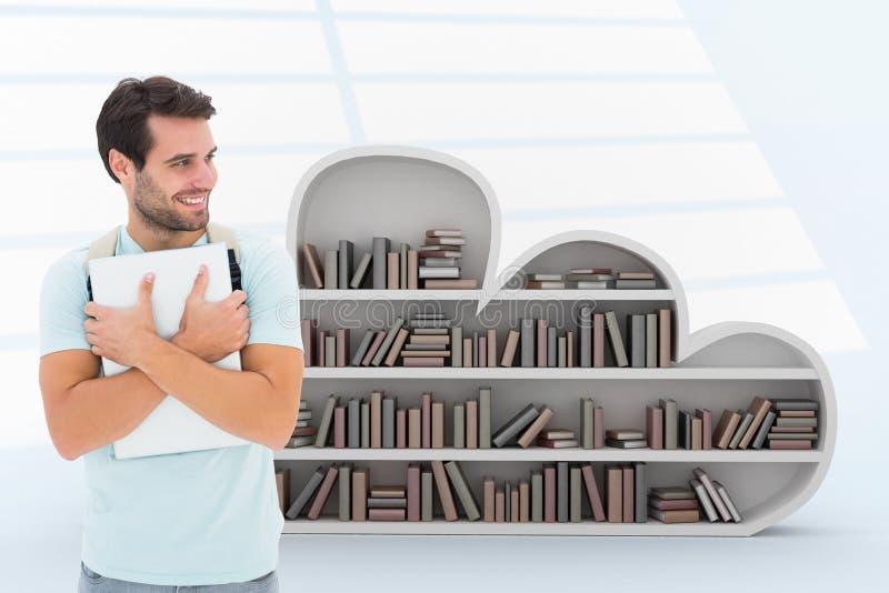 Sammansatt bild av den hållande bärbara datorn för student royaltyfria bilder