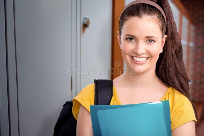 Sammansatt bild av den lyckliga studenten royaltyfri bild
