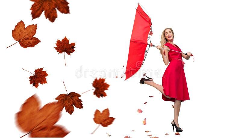 Sammansatt bild av det eleganta blonda hållande paraplyet fotografering för bildbyråer