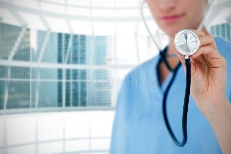 Sammansatt bild av doktorn som lyssnar med stetoskopet royaltyfria bilder