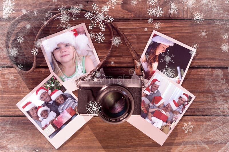 Sammansatt bild av flickan som hemma bär den santa hatten fotografering för bildbyråer