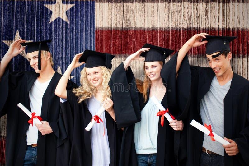 Sammansatt bild av gruppen av tonåringar som firar efter avläggande av examen royaltyfria foton