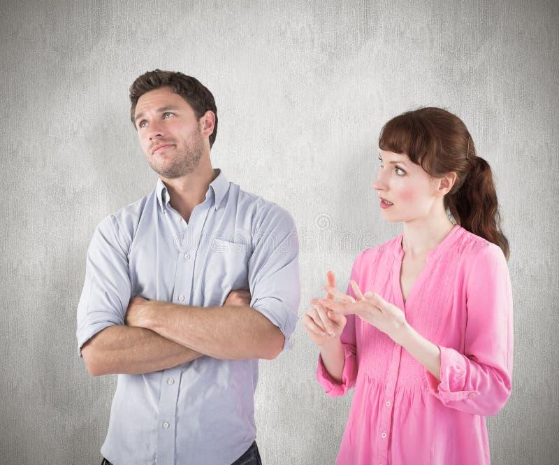 Sammansatt bild av kvinnan som argumenterar med den okänsliga mannen royaltyfri fotografi