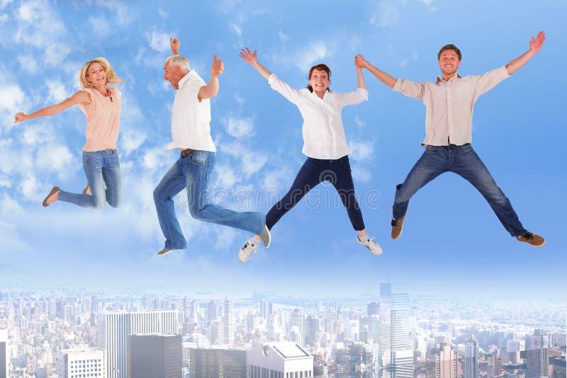 Sammansatt bild av män och kvinnor som hoppar mot vit bakgrund royaltyfri fotografi