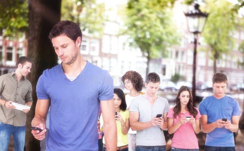 Sammansatt bild av mannen som använder hans mobiltelefon royaltyfri bild