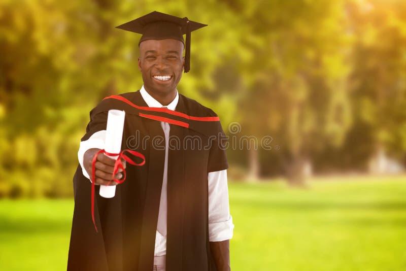 Sammansatt bild av mannen som smilling på avläggandet av examen fotografering för bildbyråer
