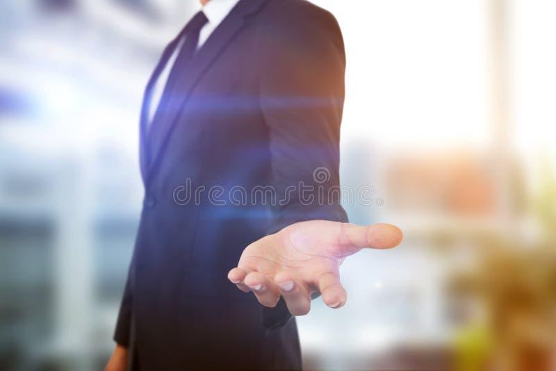 Sammansatt bild av midsectionen av affärsmanvisninghanden mot vit bakgrund arkivfoton
