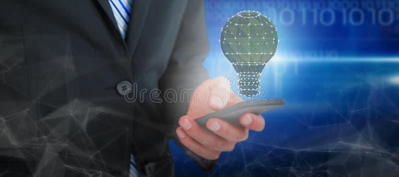 Sammansatt bild av midsectionen av affärsmantextmessaging på mobiltelefonen royaltyfri bild