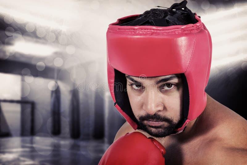Sammansatt bild av muskulös manboxning i handskar royaltyfria foton