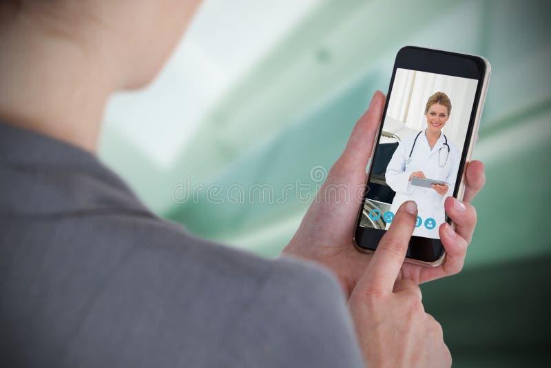 Sammansatt bild av närbilden av affärskvinnan som använder mobiltelefonen royaltyfria bilder