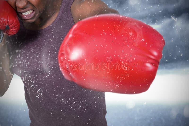 Sammansatt bild av passformmannen med boxninghandskar royaltyfria foton
