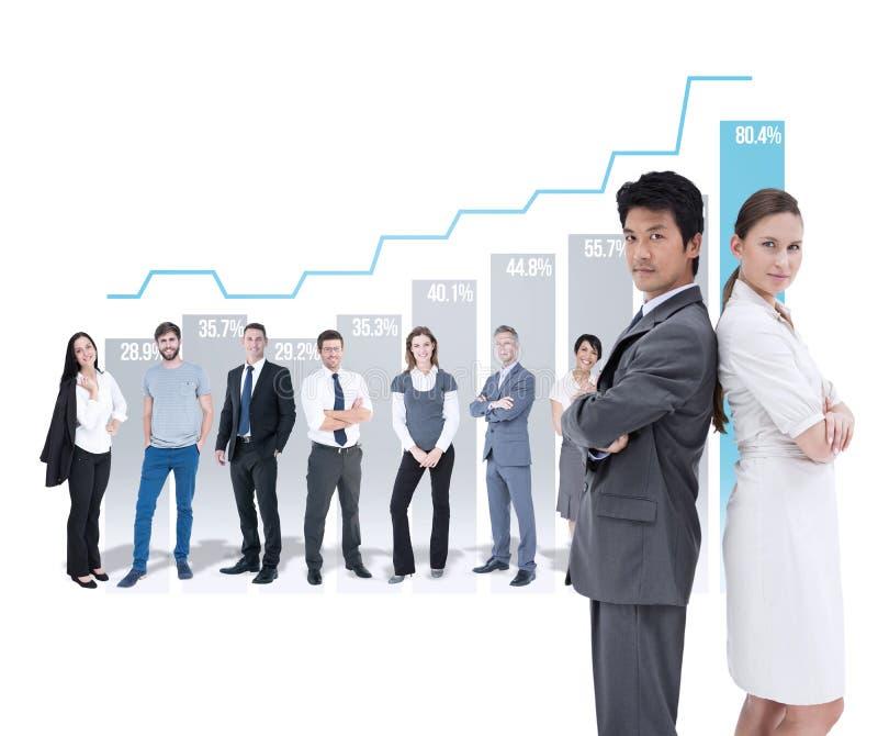 Sammansatt bild av ståenden av affärsfolk som står baksida mot baksida royaltyfria foton
