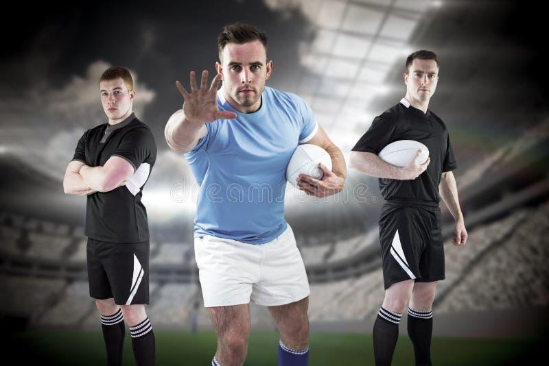 Sammansatt bild av tuffa rugbyspelare 3D royaltyfri fotografi