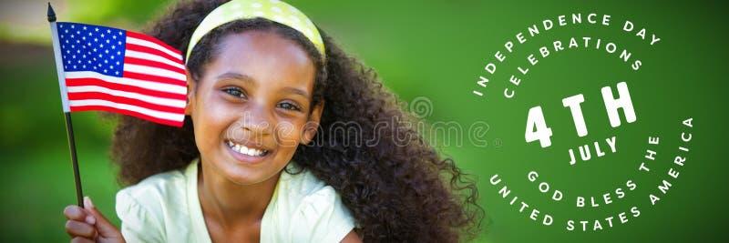 Sammansatt bild av unga flickan som firar självständighetsdagen i parkera royaltyfri bild