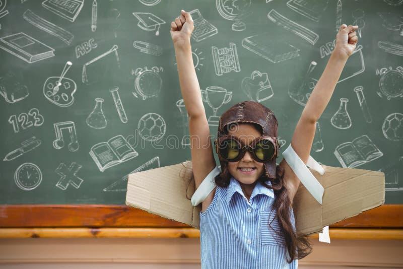 Sammansatt bild av unga flickan som låtsar för att flyga fotografering för bildbyråer