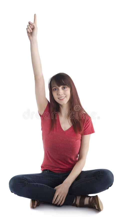 Sammanträdekvinna som lyfter hennes arm med tecknet för nummer ett royaltyfria foton