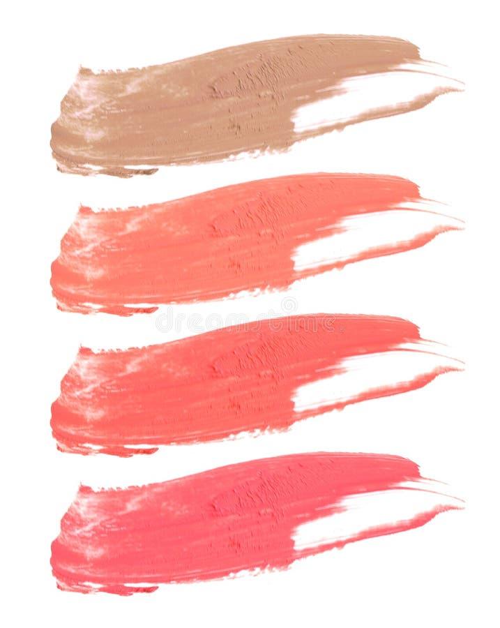 Sammlung befleckte Lippenstifte lokalisiert auf Weiß lizenzfreie stockfotos