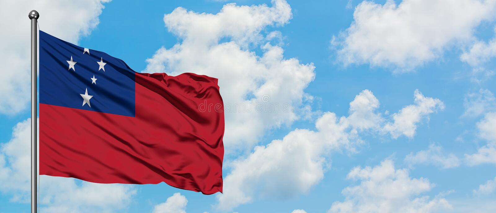 Samoa flag waving in the wind against white cloudy blue sky. Diplomacy concept, international relations.  royalty free stock photography