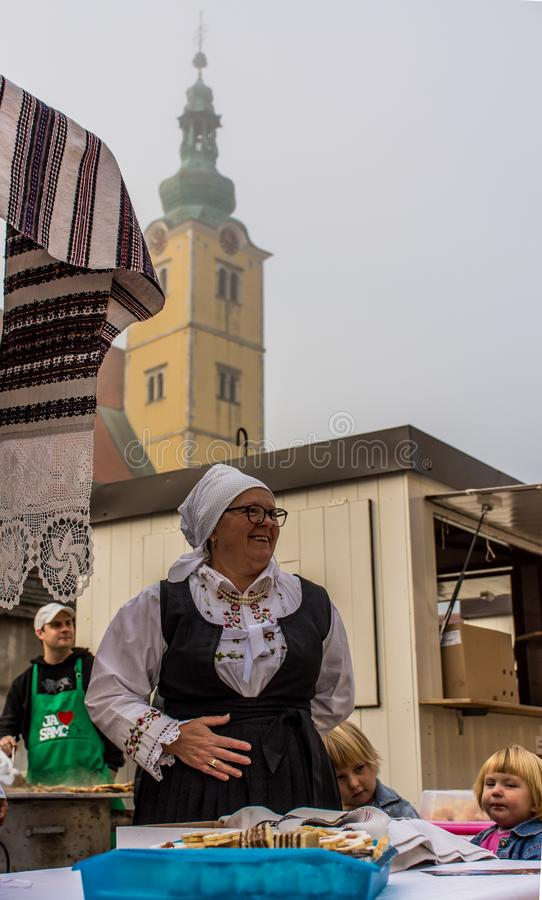 Samobor town festivities and presentation of traditional meals. Samobor, Croatia, October 20, 2018. Older lady in Samobor town celebration anniversary with royalty free stock photos