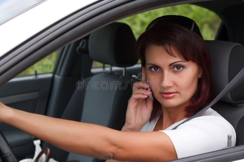 samochodowa siedząca kobieta zdjęcia royalty free