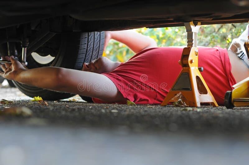 samochodowego mechanika działanie zdjęcie stock