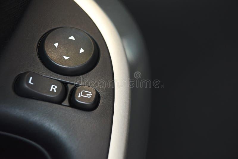 Samochodowy drzwiowy kędziorek, nadokienny guzik i strona lustrzany nastawiacz, zapinamy na samochodzie obrazy stock