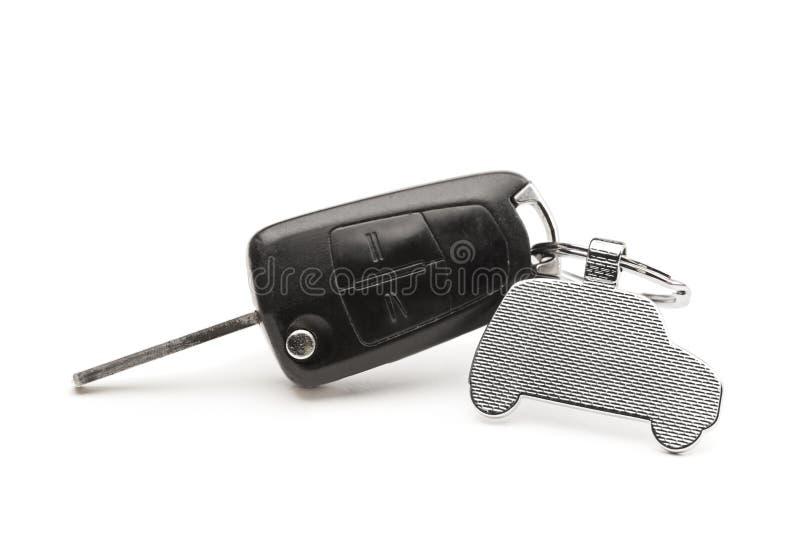 Samochodu klucz z kluczowym pierścionkiem w postaci samochodu zdjęcie stock