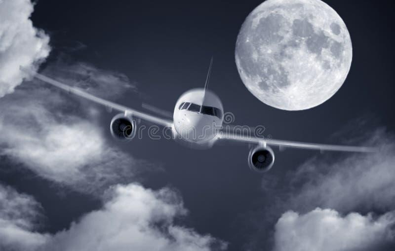 Samolot i księżyc w pełni zdjęcie stock