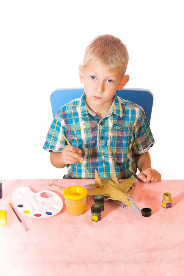 samolotowa chłopiec modela farba zdjęcie royalty free