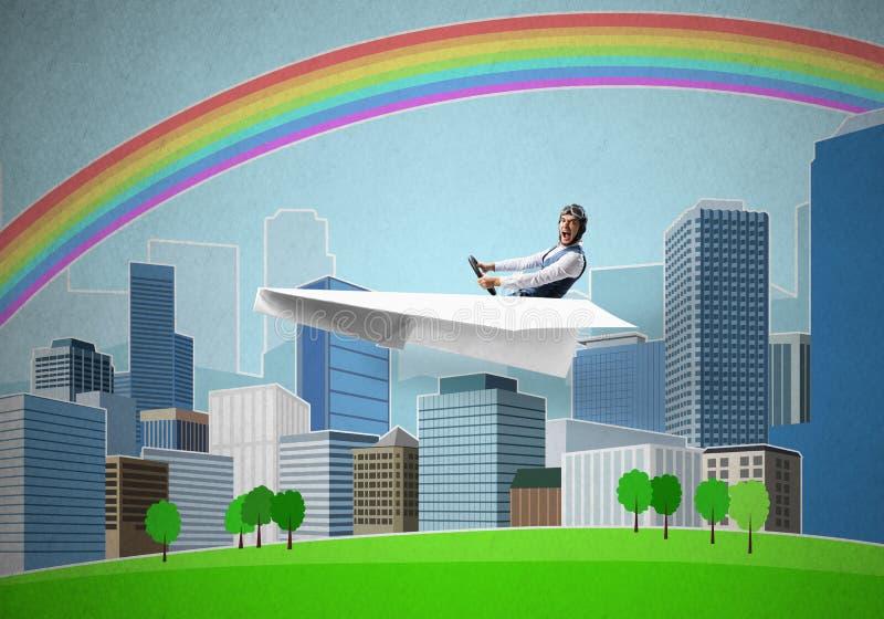 Samolotu pilotowy obsiadanie w papieru samolocie zdjęcie stock
