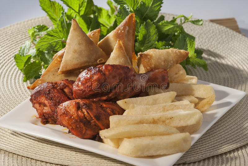Samosa & Chicken tikka with french fries royalty free stock image