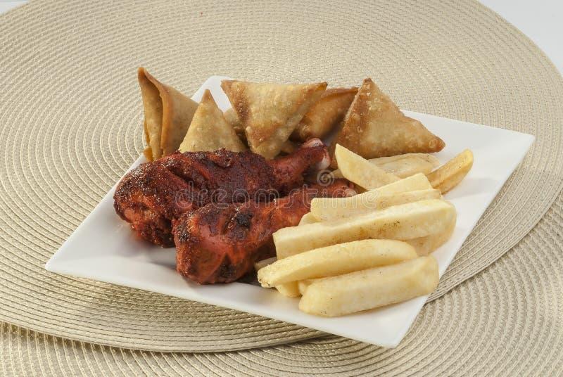 Samosa & Chicken tikka with french fries royalty free stock photos