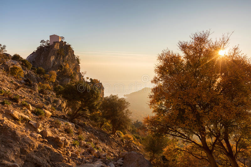 Samothrace. Small chapel on the hill at sunset stock photography