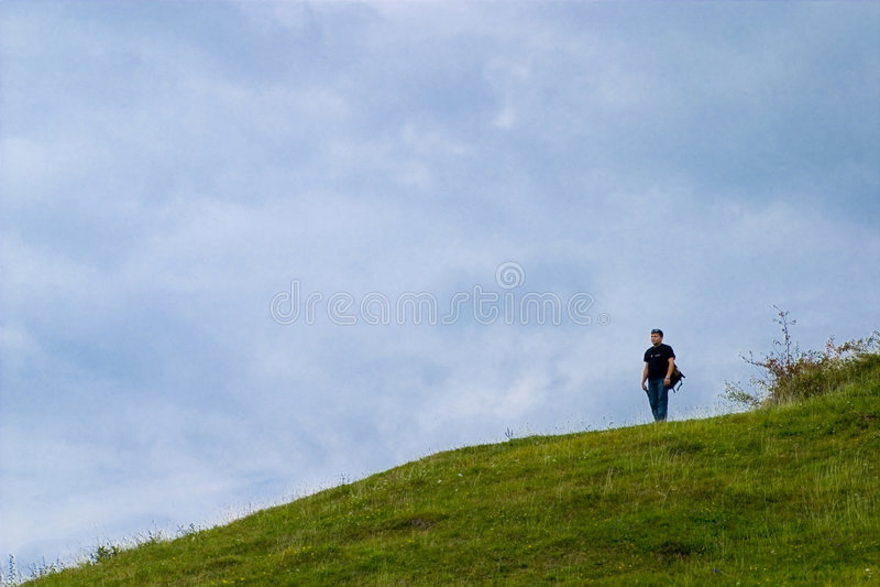samotny człowiek zbocze obraz royalty free