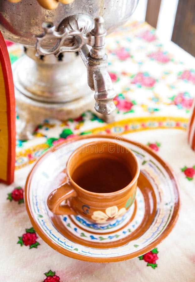 Samovar drying kettle teapot teakettle tea. Cup bowln mug plate platter on the table royalty free stock image