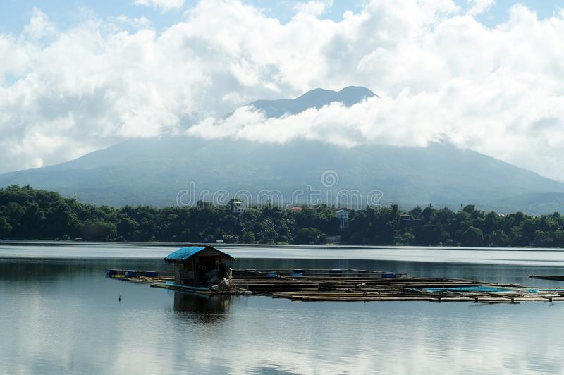 Bamboo fish cages built in the middle of mountain lake shore stock photography