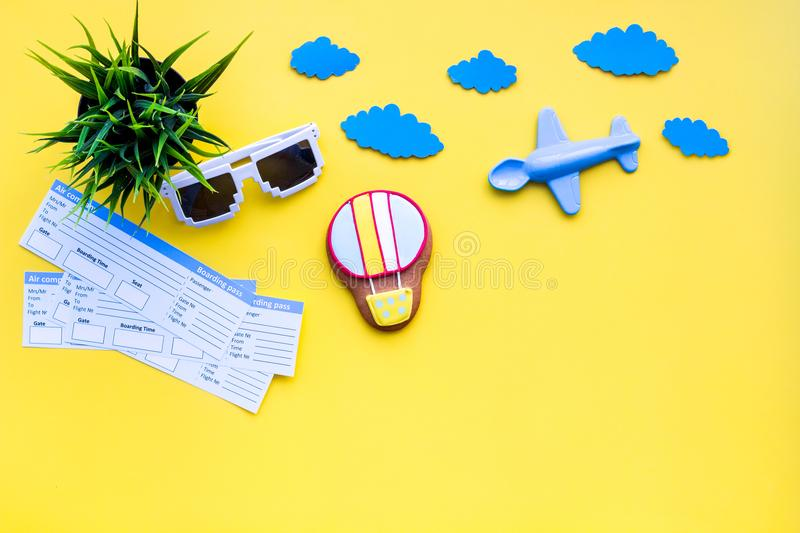 Sample of airplane ticket. Family trip with kid. Airplan, air balloon toys. Yellow background flat lay space for text stock image