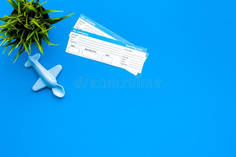 Sample of airplane ticket. Family trip with kid. Airplan toy. Blue background flat lay space for text stock photography