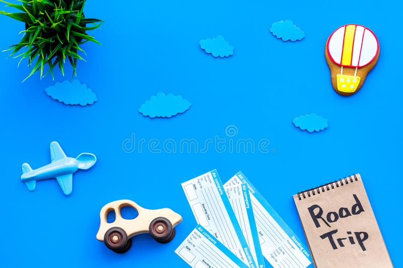 Sample of airplane ticket. Traveling with family and child. Road trip on blue background top view mock up royalty free stock photography