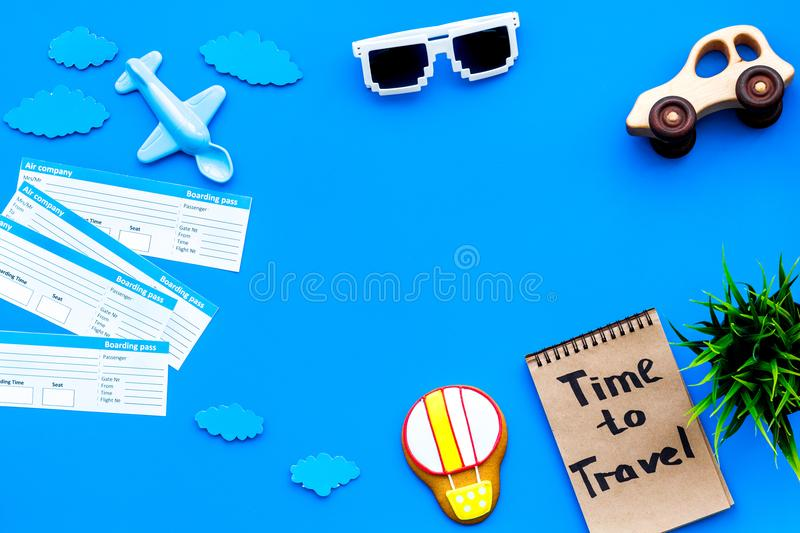 Sample of airplane ticket. Traveling with family and child. Time to travel on blue background top view mock up stock photos