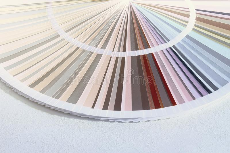 Sample Colors Catalog, Color wheel choosing paint tone. Colors royalty free stock images