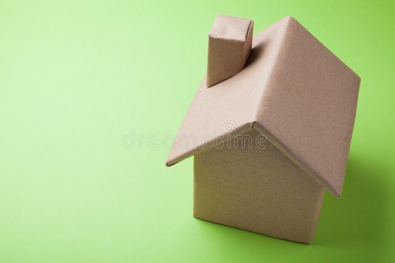 A sample of a family house on a green background.  stock images